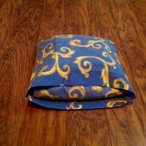 Fold the remaining excess in half and then tuck it under the bundle. Voila!