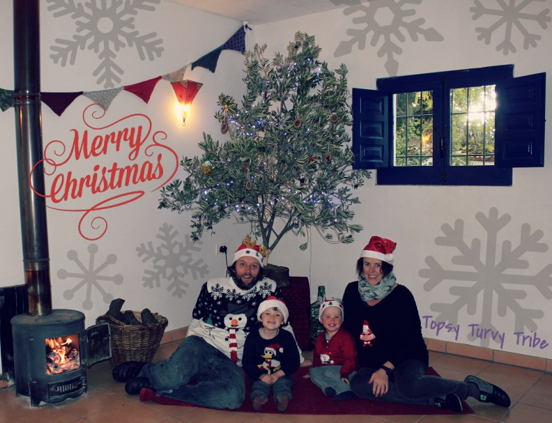 we took the opportunity to take a family photo with our eco christmas tree. The Christmas jumpers and accessories were dug out, and although we lacked a tripod the camera did pretty well balancing on top of the bin. With our camera set to the Drive Mode, self-timer continuous shooting x 10, we hoped there was a chance to capture a family photo with us all smiling. The long grass was quickly trampled down, then it is a case of pressing the button, run back to join the family and adjust the Christmas accessories before the pictures start to take. We think we managed to get the perfect photo.