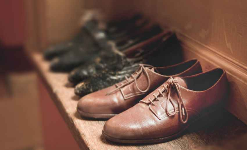 close up photography of brown leather shoes