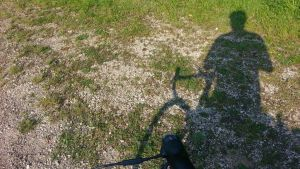 A shadow of a lonely cyclist