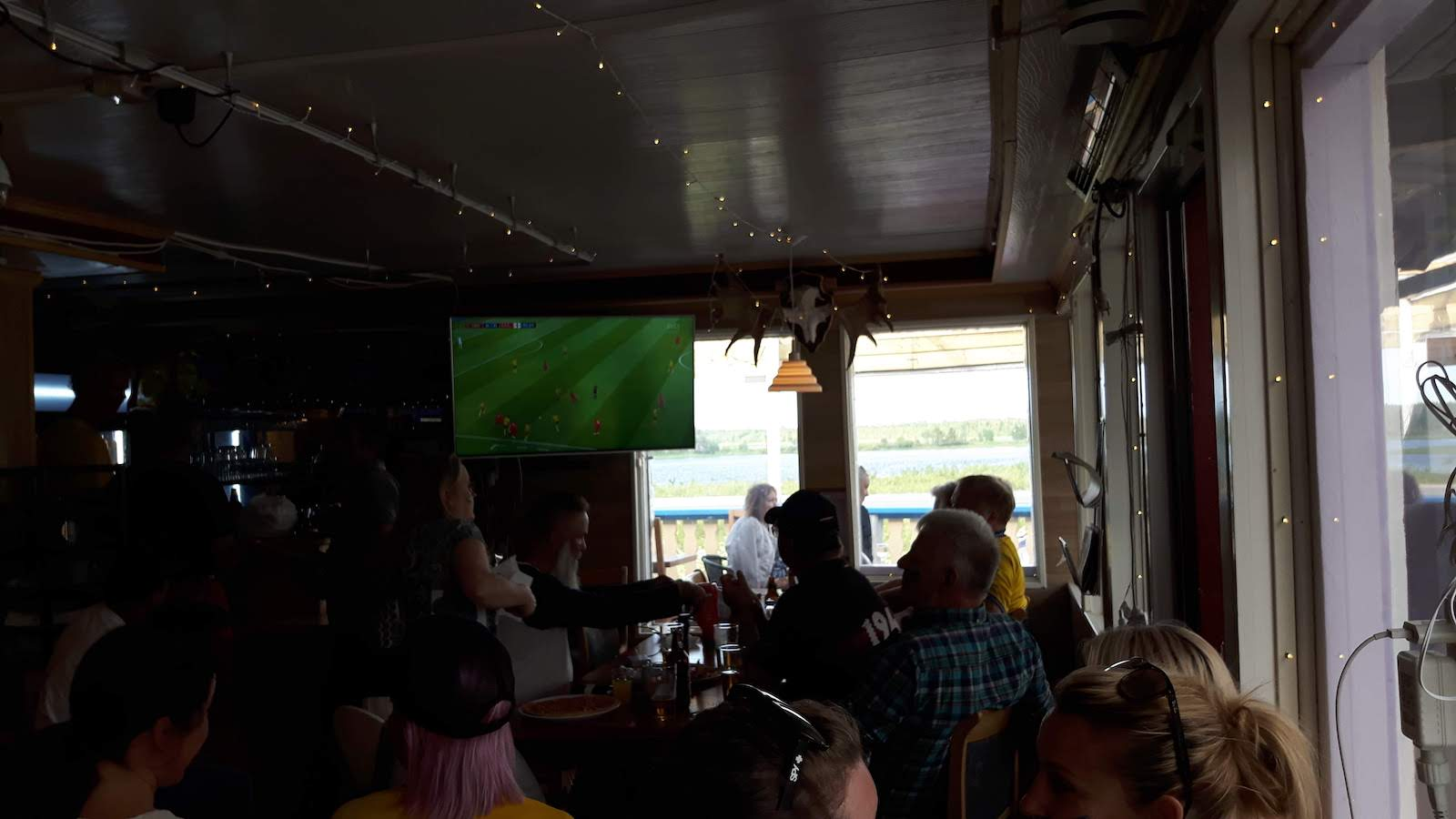 Watching the quarter final of World Cup between Sweden and England in Junosuando Sweden