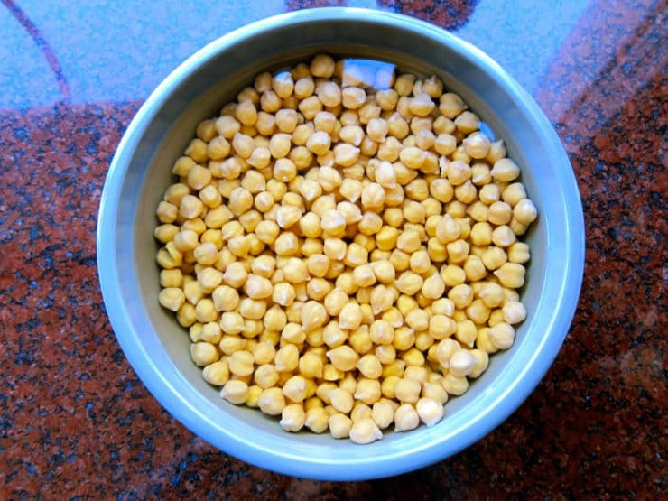 Large bowl of chickpeas soaking on countertop.