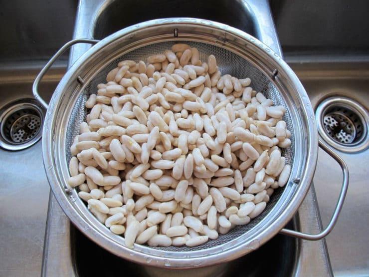 Straining beans.