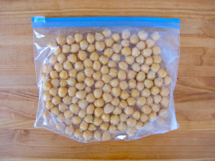 Chickpeas in single layer in plastic zipper bag, ready to freeze.