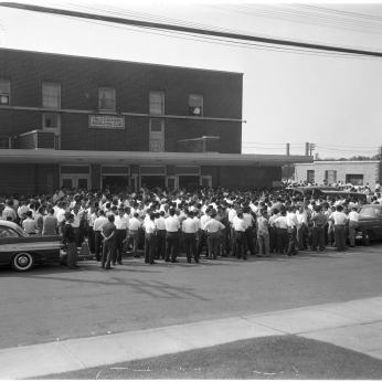Workers outside the Italo Canadian Recreation Club Hall (or Brandon Hall) during Brandon Union Group meeting. Photo by Albert Van. August 12, 1960. York University, Clara Thomas Archives and Special Collections, Toronto Telegram fonds, ASC52296.