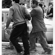 Striker hit on the head by small axe being carried away. Photo by Jack Judges. June 12, 1961. York University Libraries, Clara Thomas Archives and Special Collections, Toronto Telegram fonds, ASC52963.