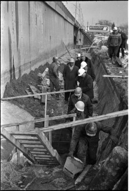Norm Pike, Gerry Gallagher, and other inspecting a bridge building project on Gerrard Street. Photo by Bruce Reed. March 2, 1967. York University Libraries, Clara Thomas Archives and Special Collections, Toronto Telegram fonds, ASC52242.