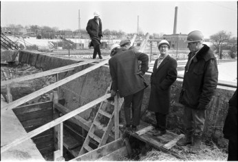 Norm Pike, Gerry Gallagher, and other inspecting a bridge building project on Gerrard Street. Photo by Bruce Reed. March 2, 1967. York University Libraries, Clara Thomas Archives and Special Collections, Toronto Telegram fonds, ASC52243.