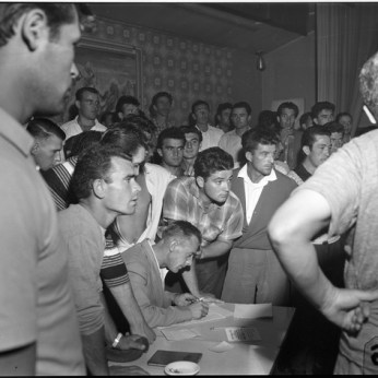 Marino Toppan signing up bricklayers to his Local 40 at Brandon Hall. August 1960. York University Libraries, Clara Thomas Archives and Special Collections, Toronto Telegram fonds, ASC52256.