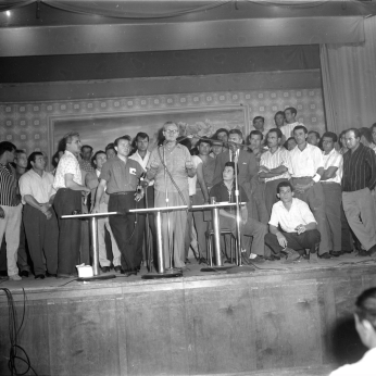 Bruno Zanini and Charles Irvine standing on stage during a Brandon Union meeting. Photo by Jack Judges. August 6, 1960. York University Libraries, Clara Thomas Archives and Special Collections, Toronto Telegram fonds.