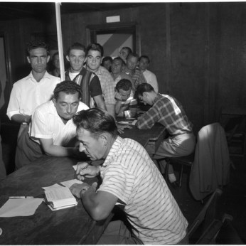 Bruno Zanini and John Stefanini signing up workers to the Bricklayers' Local 40 and Laborers' 811 at Brandon Hall. Photo by Jack Judges. August 6, 1960. York University Libraries, Clara Thomas Archives and Special Collections, Toronto Telegram fonds,