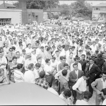 Crowd of workers gathered on the Brandon Hall parking lot. Photo by Albert Van. August 16, 1960. York University Libraries, Clara Thomas Archives and Special Collections, Toronto Telegram fonds, ASC52299.