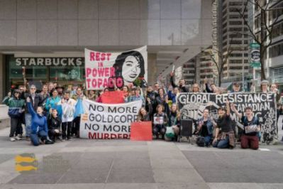 The march began with the crowd gathering at Goldcorp's Toronto office on 130 Adelaide Street for a memorial for Topacio Reynoso Pacheco. This 16 year old mining resistance activist was murdered a year ago for her resistance to the Escobal mining project, jointly owned by Goldcorp and Tahoe Resources.