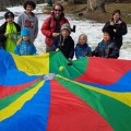 march break kids with parachute