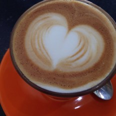 Organic cappuccino or any espresso based beverage with organic beans and milk.