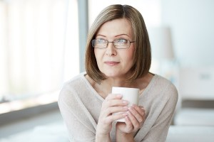 Portrait of calm mature woman with cup.
