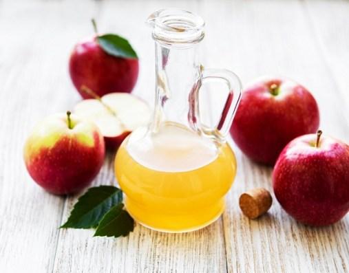 Apple cider vinegar on a old wooden table