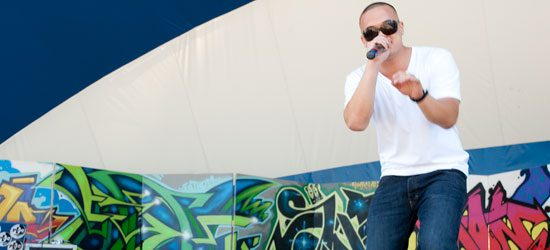 Tim Wilkinson, a rapper also known as Karma, performs one of his songs.
