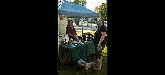 Market customer Joy Hann buys her dogs special doggie biscuits.