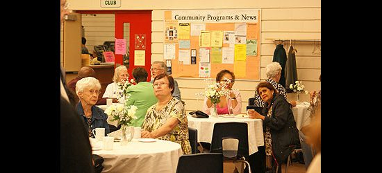 Members of the Port Union community relax with refreshments at the 25th anniversary of the Port Union Community and Recreation Centre.