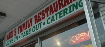 The sign that hangs above Nadi's family restaurant.