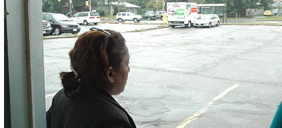 Nadi stands outside her restaurant, pondering what the future will hold for her and her daughter.