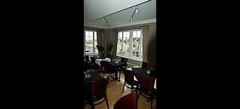 The Olde Stone Cottage has a more formal dining room as well as seats at the bar and regular tables.