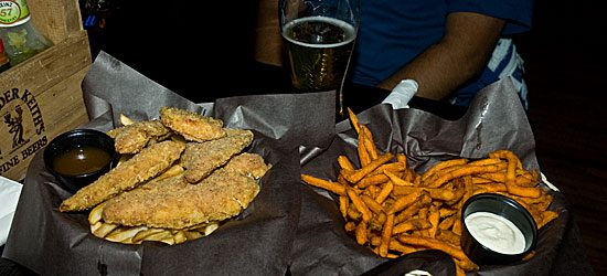 """Intrepid Observer reporter Laura Ross sampled some of the Stone Cottage's cooking. Chicken fingers and regular fries, as well as a side of sweet potato fries. """"Mmmmmm,"""" Ross said."""
