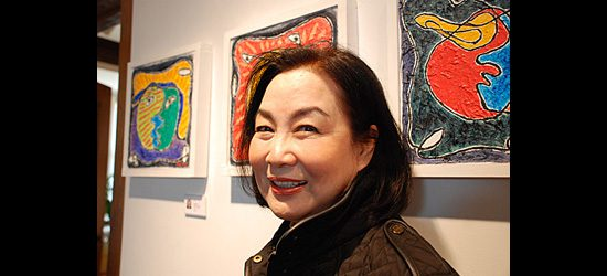 C.C. Yun showcases her oil paintings, part of her collection called Relation.