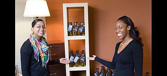 Carla Madho and Fernelle Edmund show off Second Base Youth Shelter's foray into gourmet cooking oils.