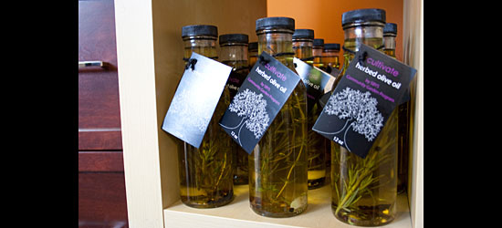 A close up of the oils, made in-house, with herbs from Second Base Youth Shelter's garden.
