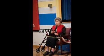Elder Lillian McGregor speaks to the audience.