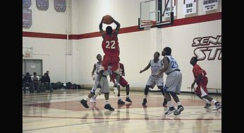 West Hill's Kevon Parchment fakes a shot and dishes to teammate Brandon Burke Feb. 11 against the Sir Wilfrid Laurier Blue Devils.