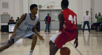 Warrior's shooting guard Mohammed Swaray #44, tries to dribble past defending Blue Devil Cameron Mars.