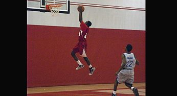 West Hill center and forward, Michael Knight #23, dunks the ball to give his team two points late in the game.
