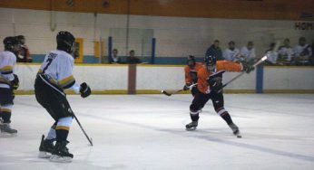 Bendale forward, Chris Pearce #9, crosses the blue line, and winds up to rip a slap shot past two Lions defenders; Daily and Iserhoff.