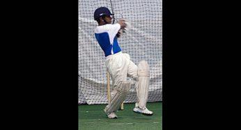 A boy in the Under 15 program at North Star Cricket bats.