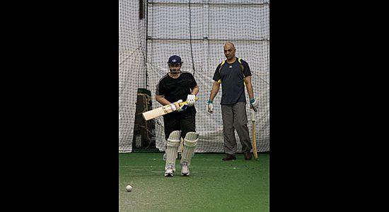 A batsman in the Under 15 program works on technique.