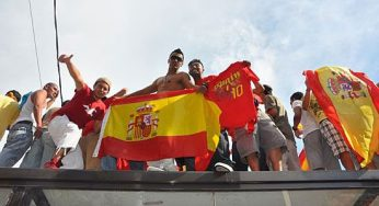 These fans proudly wave their flag to celebrate Spain's win