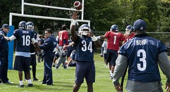 Practice roster RB Mike Ford catches a pass from CFL leading rusher Cory Boyd.