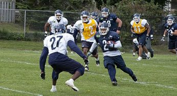 Wide receiver Chad Owens looks to juke past defensive back Sammy Joseph.