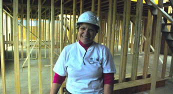 First-time Habitat for Humanity Toronto volunteer Eva Dornellas helps build 29 townhouses at 4572 Kingston Rd. on Sept. 24. She said she's happy to volunteer especially because the build site is in her neighbourhood.