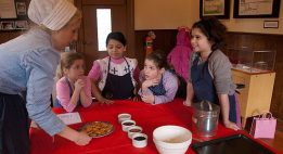 From left to right: Michelle Ridout, a museum volunteer, helps Saige Tsolakis, 6, Valeria Ruiz, 6, Sierra Tsolakis, 8, and Grace Oly, 9, learn to bake a Victorian dessert. The children took part in a baking workshop at the Scarborough Museum Dec. 3, as part of the museum's Festive Christmas weekends, which run the first three weekends in December.