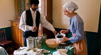 Volunteers dressed in period costumes prepare a baking demonstration at the Scarborough Museum Dec. 3, as part of the museum's Festive Christmas weekends, which run the first three weekends in December.