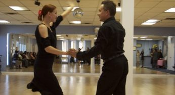 Natasha and Slava Fedorov show off one of their American ballroom routines for visitors at Shall We Dance studio's 7th anniversary open house on Oct. 1.