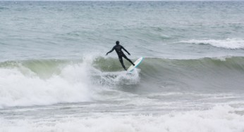 A surfer rides the waves at the Scarborough Bluffs. The fall is the best time to try to catch a wave due to more winds.