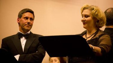 Michele, left, smiling slyly at his mistress, Desidera.