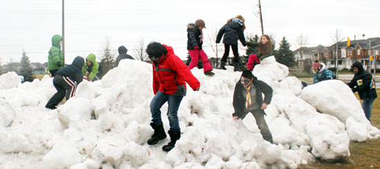 Children play outside, at the Port Union Community Centres Winterfest. This was the only snow to be seen at the event.
