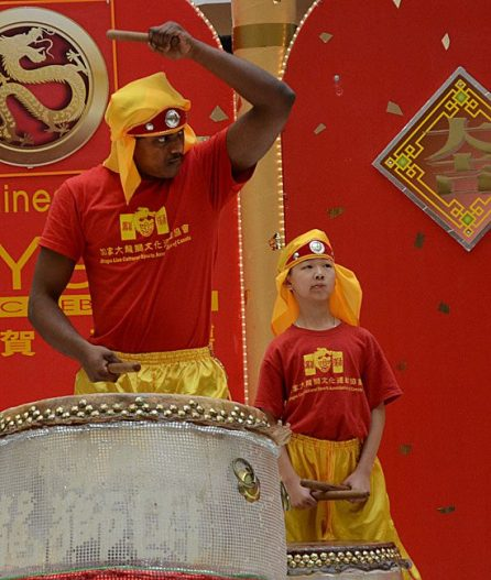 Martial arts student Kavin Ketheeswaran, left, sounds the thunder drum during Sunday's Chinese New Year celebration at Scarborough Town Centre.
