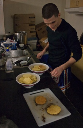 Matt Embree cooking a meal after a long training session to recover. Fighters who are scheduled for tournaments live in the Siam No. 1 gym for about a month prior to their big fights. The gym is capable of accommodating the fighters for that period of time before their fights.